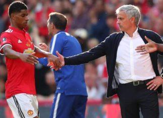 Jose Mourinho shaking hands with Marcus Rashford