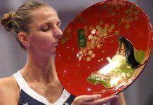 Karolina Pliskova displays her title to the camera