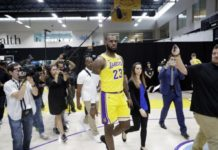 Members of the media follow Los Angeles Lakers' LeBron James (23)
