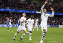 France's Kylian Mbappe, right, celebrates after scoring a goal during a friendly soccer match