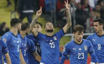 Italy's Cristiano Biraghi, center, celebrate with his teammates