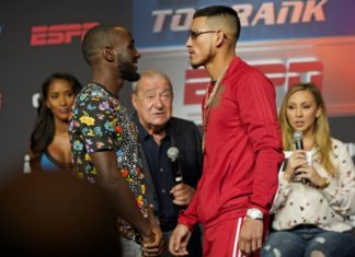 """Jose Benavidez Jr., right, and Terence """"Bud"""" Crawford face each other"""