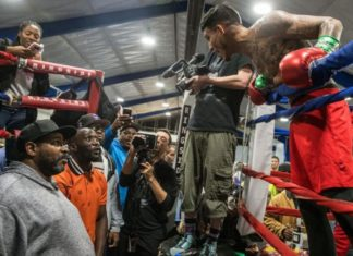 Jose Benavidez Jr., right, gets into a shouting match with Brian McIntyre, left, and Terence Crawford