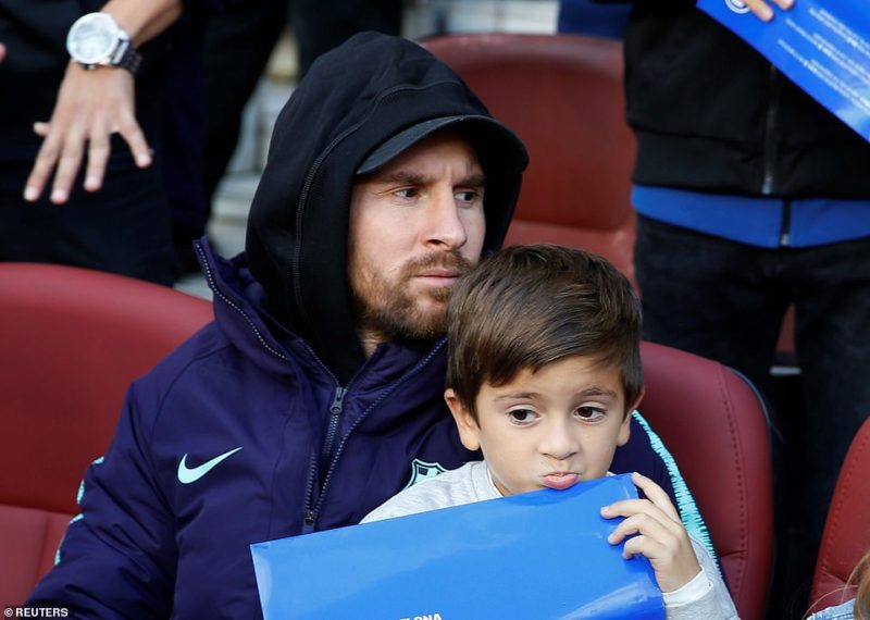 Lionel Messi, currently [injured] watches the match from the Nou Camp sidelines