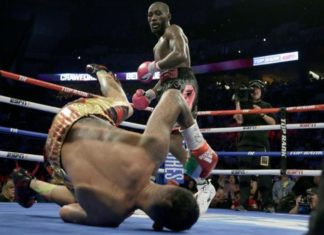 Terence Crawford watches as Jose Benavidez goes down in the 12th round