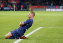 The France international celebrates in style after completing his treble