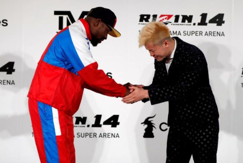 Floyd Mayweather Jr. shakes hands with his opponent Tenshin Nasukawa