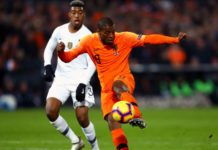 Georginio Wijnaldum of the Netherlands shoots while under pressure