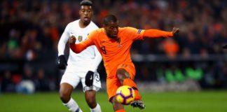 Georginio Wijnaldum of the Netherlands shoots while under pressure