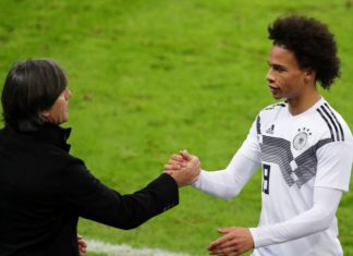 Leroy Sane of Germany shake hands after his substitution with Head coach Joachim Loew