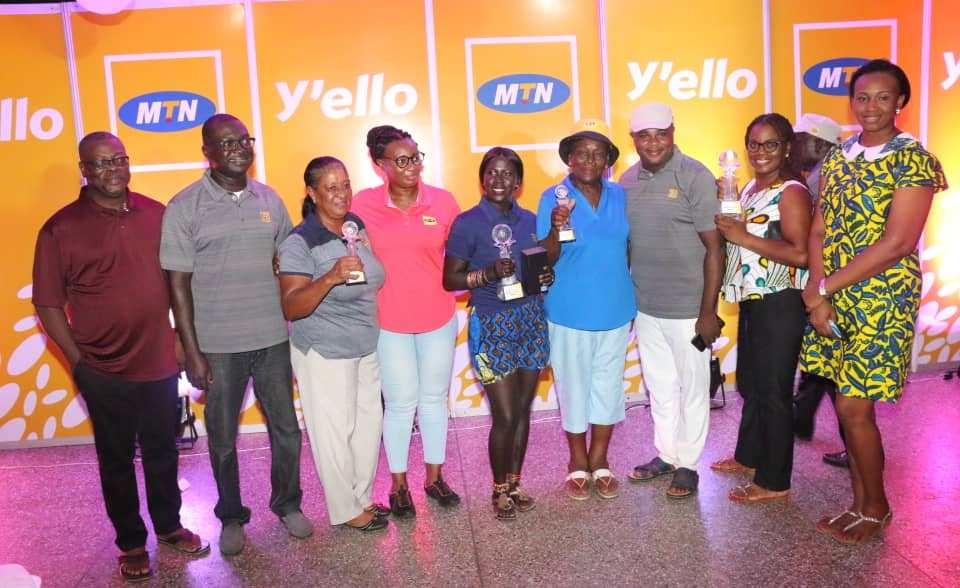Winners of the just ended MTN Invitational Golf Tournament displaying their trophies