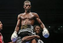 Richard Commey being carried on a shoulder high by Carl Lokko