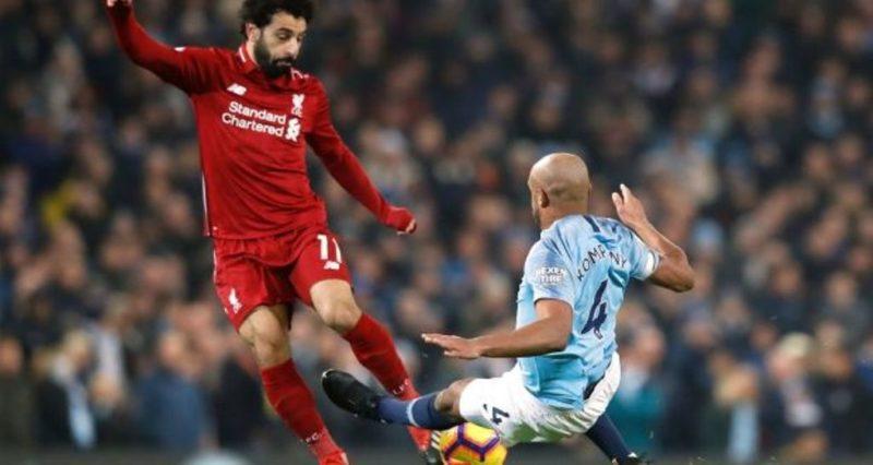 Manchester City's Vincent Kompany tackles Liverpool's Mohamed Salah