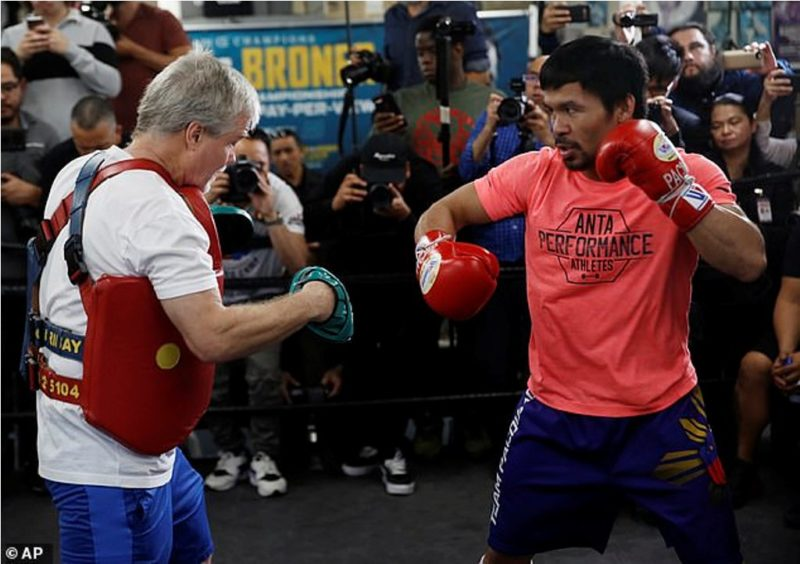The Filipino is put through a session on the pads by long time trainer Freddie Roach