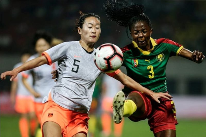 Ajara Nchout Njoya tangles with China's Wu Haiyan during a friendly